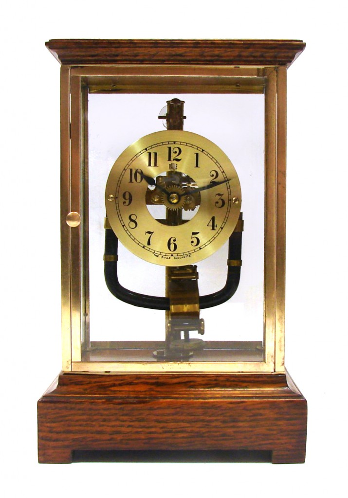 An Early 1930s Electrical Bulle Four Glass Mantel Clock